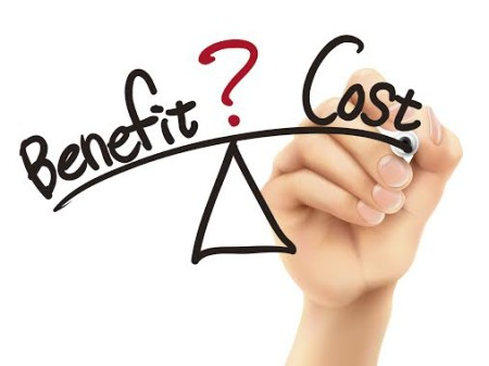 balance between benefit and cost written by 3d hand over white background